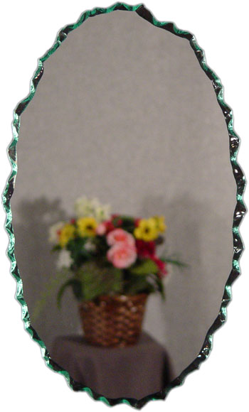 Chipped oval frameless mirror